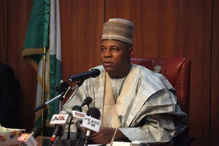 Borno state Governor Kashim Shettima speaks to a team of military investigators from the Defence Ministry during a meeting in Maiduguri