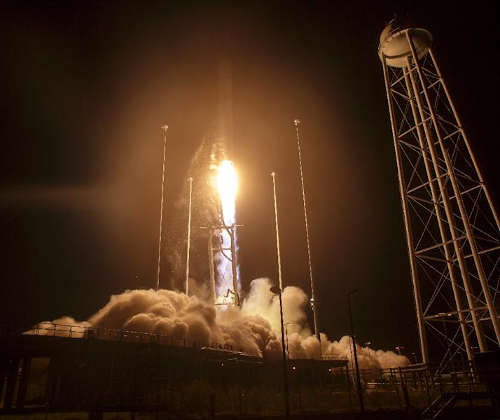 The Orbital ATK Antares rocket, with the Cygnus spacecraft onboard, takes off on October 17, 2016 at NASA's Wallops Flight Facility in Virginia (AFP Photo/NASA/Bill Ingalls)
