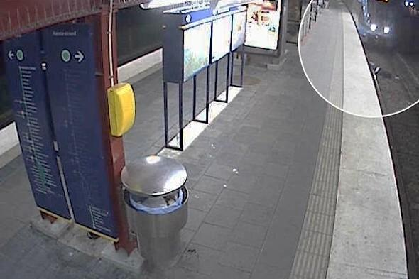 Shock pics: Thief robs drunk man on train track and leaves him to die