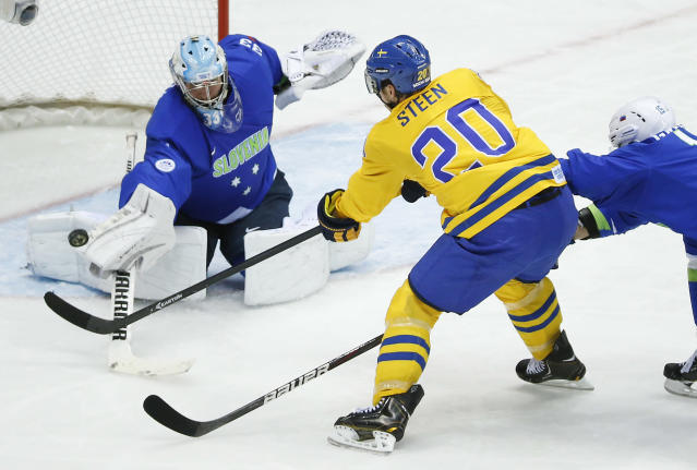 Sweden forward Alexander Steen takes a shot on goal against Slovenia goaltender Robert Kristan in the second period of a men's quarterfinal ice hockey game at the 2014 Winter Olympics, Wednesday, Feb. 19, 2014, in Sochi, Russia. (AP Photo/Mark Humphrey)