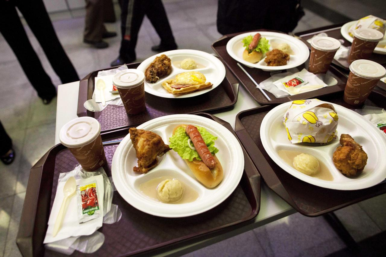 In this April 16, 2011 photo, plates of food sit on a customer's table at a fast food restaurant inside an amusement park in Pyongyang, North Korea. (AP Photo/David Guttenfelder)