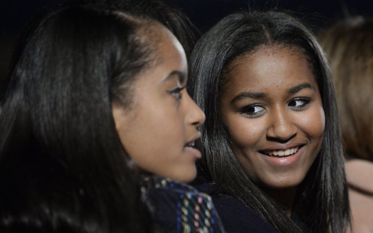 Malia and Sasha Obama attend the national Christmas tree lighting ceremony on the Ellipse south of the White House on Dec. 3, 2015. in Washington, DC.
