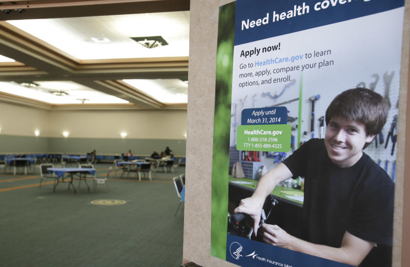 A poster touting health insurance hangs on a door to a nearly empty room at a convention center in Texas City, Texas, Saturday, March 1, 2014. Though organizers had recruited assisters to handle as many as 400 people seeking help in navigating the federal insurance marketplace, only a handful had come by in the first hours of operations. (AP Photo/Pat Sullivan)