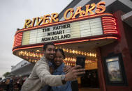 "Jeet Singh and Rubi Morgan take a selfie with the River Oaks Theatre marquee after watching ""Minari"" on the second last day of the theater Wednesday, March 24, 2021, in Houston. The pair was going to buy tickets of the last screening of the theater, but the show was sold out so they picked the second last day. (Yi-Chin Lee/Houston Chronicle via AP)"