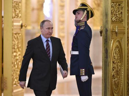 Russia's President Putin arrives to chair a meeting at the Kremlin, in Moscow