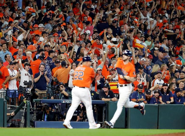 Fans cheer as Houston's Kyle Tucker rounds the bases after hitting a home run in the seventh inning of the Astros' 9-4 victory over the Chicago White Sox in game two of the American League Division Series (AFP/Bob Levey)