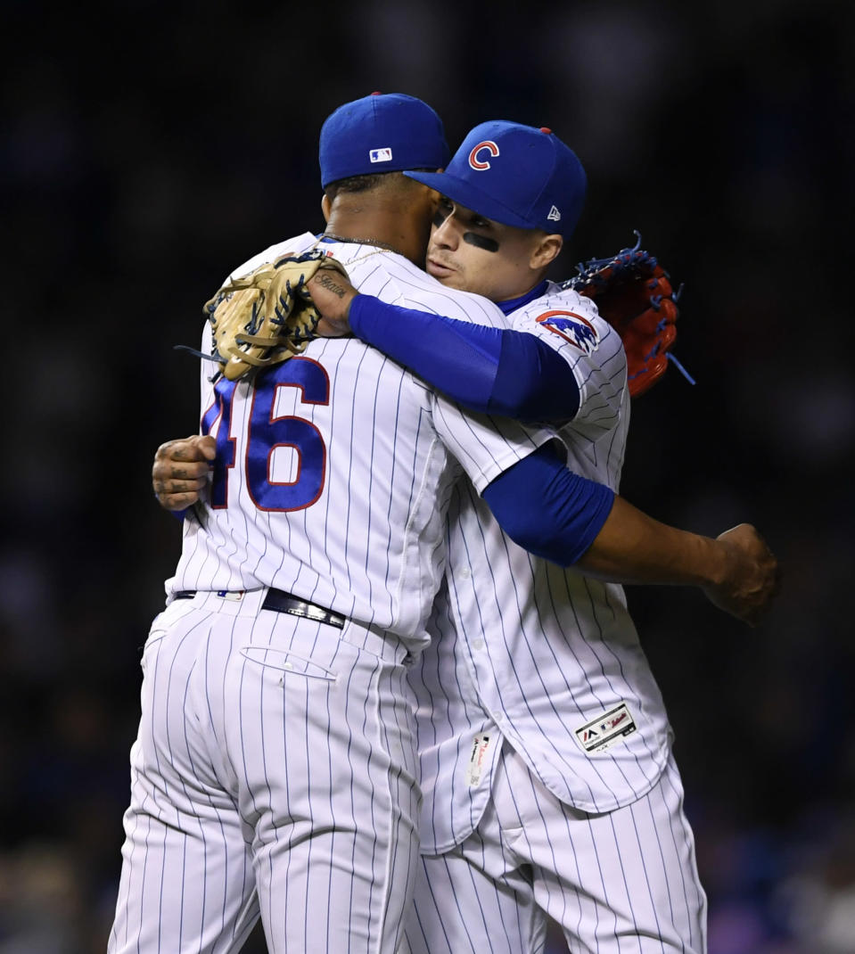 Chicago Cubs closing pitcher Pedro Strop, left, celebrates with teammate Javier Baez after the team defeated the Los Angeles Dodgers 7-6 during a baseball game, Wednesday, April 24, 2019, in Chicago. (AP Photo/Paul Beaty)