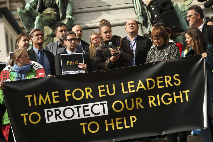 German boat captain Carola Rackete, center, talks during a protest outside the European Parliament in Brussels, Thursday, Oct. 3, 2019. The captain of a humanitarian rescue ship arrested for docking the vessel in an Italian port without authorization is taking aim at the European Union for outsourcing the handling of migrants crossing the Mediterranean to conflict-ravaged Libya. (AP Photo/Francisco Seco)