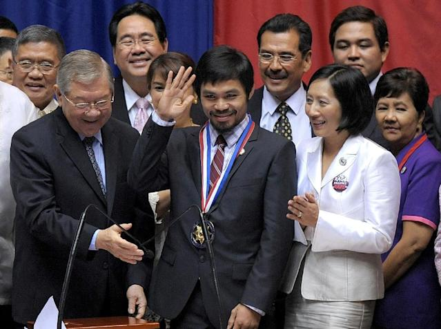 Philippine boxer and congressman Manny Pacquiao (centre) receives the Congressional Medal of Distinction at the House of Representatives in Quezon City, Manila in November 2010 (AFP Photo/Noel Celis)