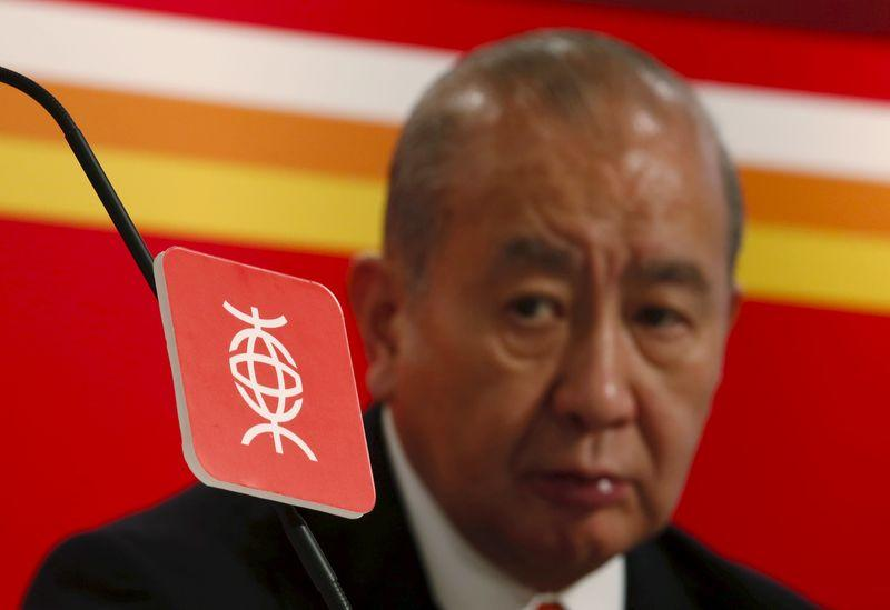 File photo of Bank of East Asia Chairman and Chief Executive David Li looking on behind a logo of the bank during a news conference in Hong Kong