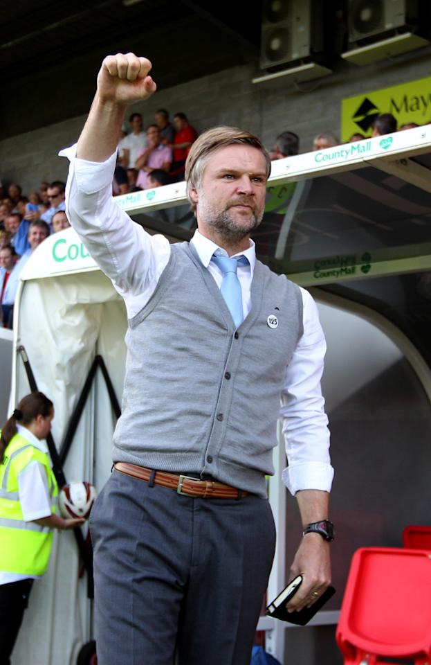 Coventry City's manager Steven Pressley shows his support to the away fans before the start of the match during the Sky Bet League One match at Broadfield Stadium, Crawley.