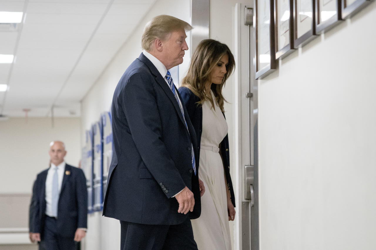 President Donald Trump and first lady Melania Trump, right, depart after visiting with medical staff at Broward Health North in Pompano Beach, Fla., Friday, Feb. 16, 2018, following Wednesday's shooting at Marjory Stoneman Douglas High School, in Parkland, Fla. (AP Photo/Andrew Harnik)