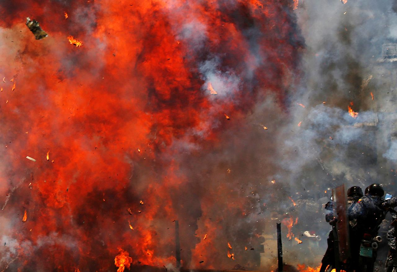 <p>Flames erupt as clashes break out while the Constituent Assembly election is being carried out in Caracas, Venezuela, July 30, 2017. (Carlos Garcia Rawlins/Reuters) </p>