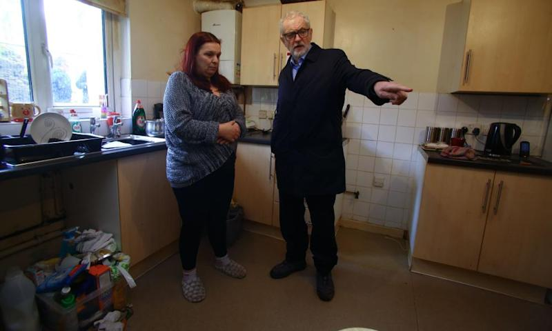 Jeremy Corbyn meets Theresa Davies, who has been affected by flooding, in Rhydyfelin village, south Wales.