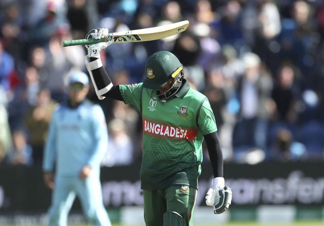 Bangladesh's Shakib Al Hasan celebrates his century during the ICC Cricket World Cup group stage match between England and Bangladesh at the Cardiff Wales Stadium in Cardiff, Saturday, June 8, 2019. ( David Davies/PA via AP)