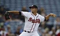 Atlanta Braves starting pitcher Mike Minor works in the first inning of a baseball game against the Colorado Rockies in Atlanta, Wednesday, July 31, 2013. (AP Photo/John Bazemore)