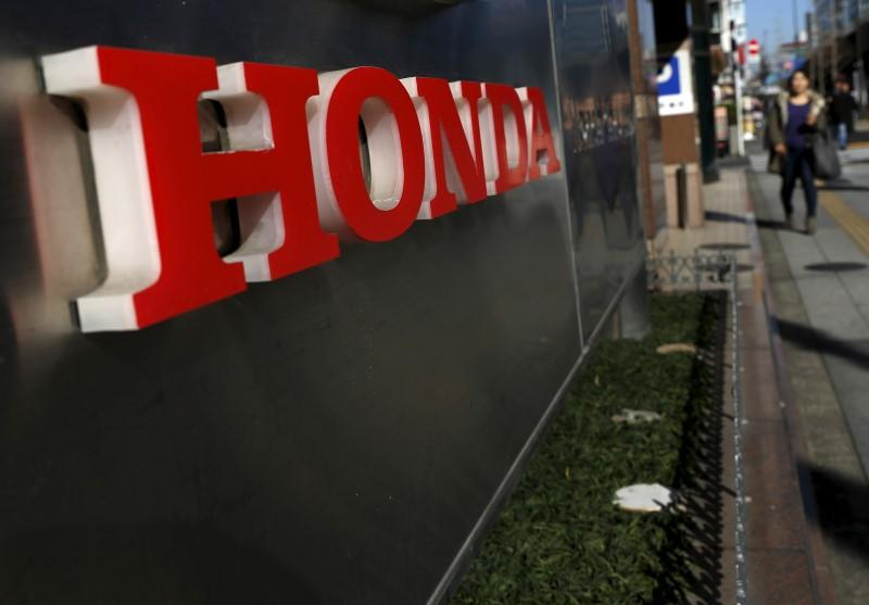 A logo of Honda Motor Co is seen outside the company's dealership in Tokyo