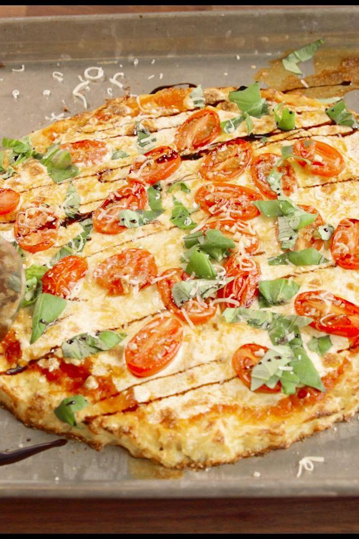 "<p>We finally cracked a crust that works—and tastes amazing.</p><p>Get the recipe from <a href=""https://www.delish.com/cooking/recipe-ideas/recipes/a47565/cauliflower-crust-pizza-recipe/"" rel=""nofollow noopener"" target=""_blank"" data-ylk=""slk:Delish"" class=""link rapid-noclick-resp"">Delish</a>.</p>"