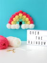 """<p>Encourage her to always follow the rainbow with this pom-pom wall decor, which she can leave up year-round. </p><p><em><a href=""""https://www.whitehousecrafts.net/single-post/2018/02/22/DIY-POM-POM-RAINBOW-ART"""" rel=""""nofollow noopener"""" target=""""_blank"""" data-ylk=""""slk:Get the tutorial at White House Crafts »"""" class=""""link rapid-noclick-resp"""">Get the tutorial at White House Crafts »</a></em></p>"""