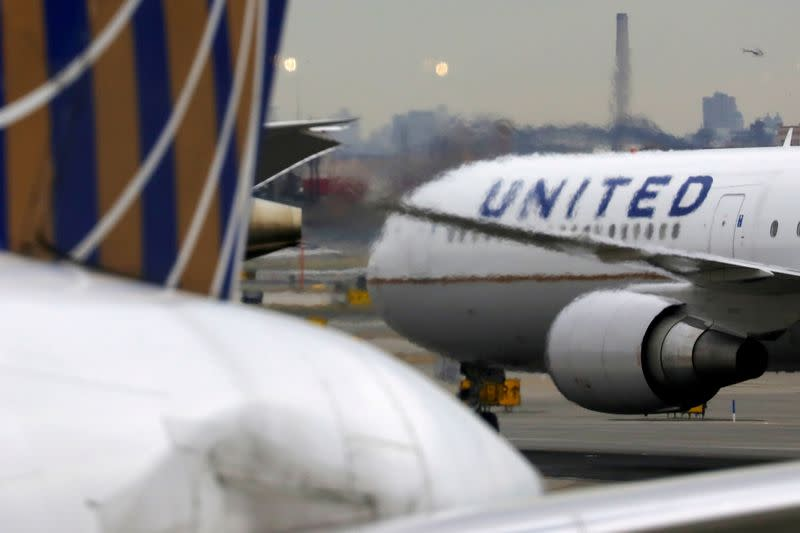 FILE PHOTO: A United Airlines passenger jet taxis at Newark Liberty International Airport