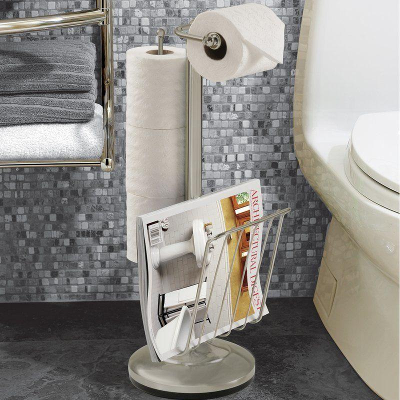 """This holder doubles as a magazine rack. <a href=""""https://www.wayfair.com/Better-Living-Products-Free-Standing-Toilet-Paper-Holder-KBW1030.html?SSAID=595441&refid=SS595441&creative=549761&m=11035&piid=7442645"""" target=""""_blank"""">Get it here</a>, $42."""