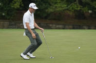 Justin Thomas reacts to his missed par putt on the 11th hole during the third round of the Masters golf tournament on Saturday, April 10, 2021, in Augusta, Ga. (AP Photo/David J. Phillip)
