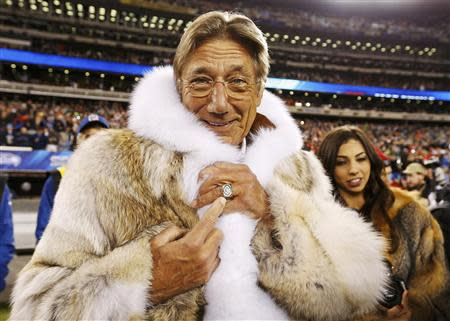Former New York Jets quarterback Joe Namath points to his championship ring before the Seattle Seahawks play the Denver Broncos in the NFL Super Bowl XLVIII football game in East Rutherford, New Jersey, February 2, 2014. REUTERS/Carlo Allegri