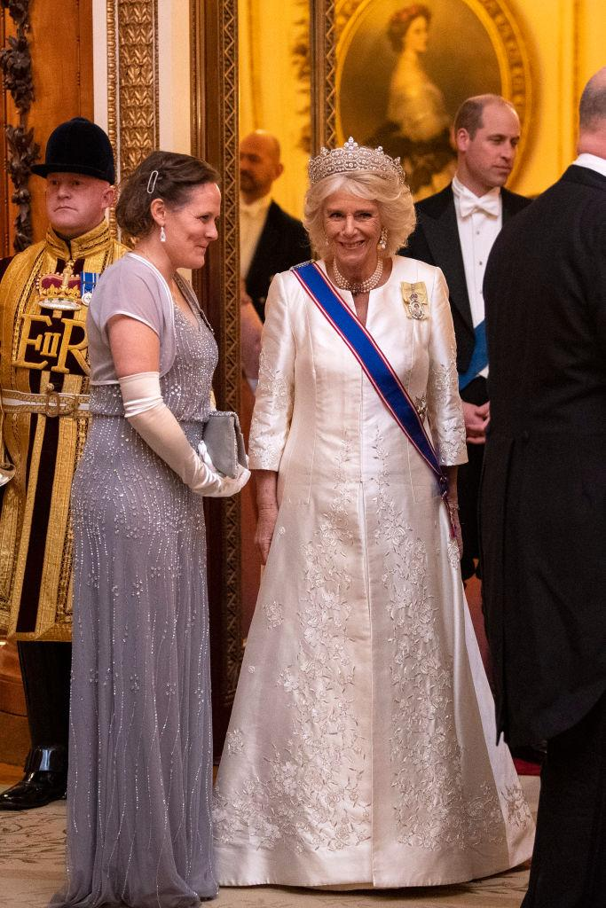 The Duchess of Cornwall also wore a sash and yellow ribbon [Photo: Getty]