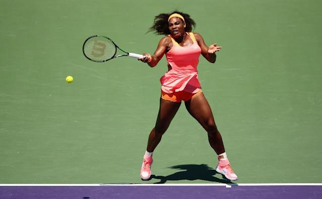 Serena Williams of the United States plays a forehand against Carla Suarez Navarro of Spain in the final during the Miami Open on April 4, 2015 in Key Biscayne, Florida (AFP Photo/Clive Brunskill)