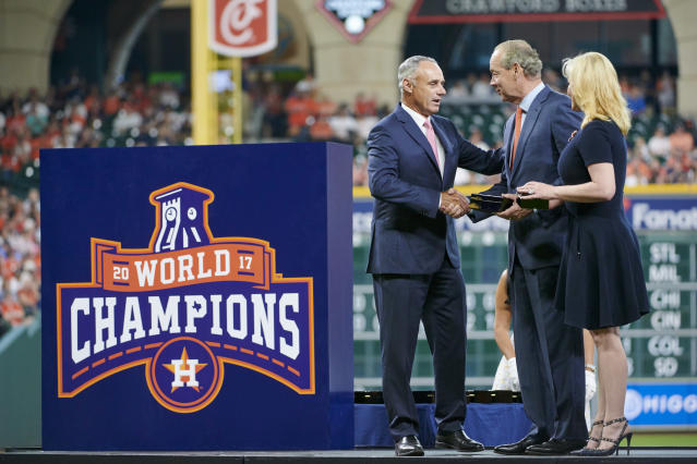 "Rob Manfred, seen here presenting <a class=""link rapid-noclick-resp"" href=""/mlb/teams/houston/"" data-ylk=""slk:Astros"">Astros</a> owner Jim Crane with his World Series ring, says MLB investigators looked into complaints about Houston's sign-stealing habits, but didn't find evidence of wrongdoing until <a class=""link rapid-noclick-resp"" href=""/mlb/players/9078/"" data-ylk=""slk:Mike Fiers"">Mike Fiers</a> went to the media. (Photo by Cooper Neill/MLB via Getty Images)"