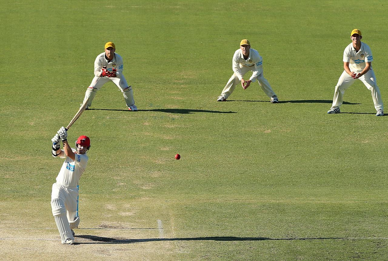 PERTH, AUSTRALIA - NOVEMBER 15:  Travis Head of the Redbacks hits out during day four of the Sheffield Shield match between the Western Australia Warriors and the South Australian Redbacks at WACA on November 15, 2012 in Perth, Australia.  (Photo by Paul Kane/Getty Images)