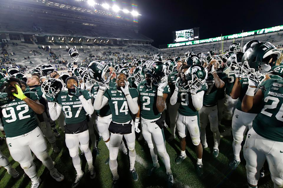 Michigan State players celebrate the 19-16 win over Maryland, Saturday, Nov. 30, 2019, in East Lansing.