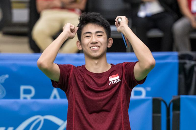 Singapore paddler Koen Pang raises his arms in triumph after beating compatriot Clarence Chew for the men's singles gold at the SEA Games. (PHOTO: Sport Singapore)