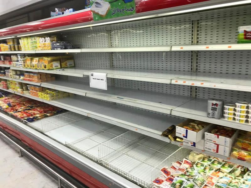 Empty shelves are seen where French products were displayed, after Kuwaiti supermarkets' boycott on French goods, in Kuwait City