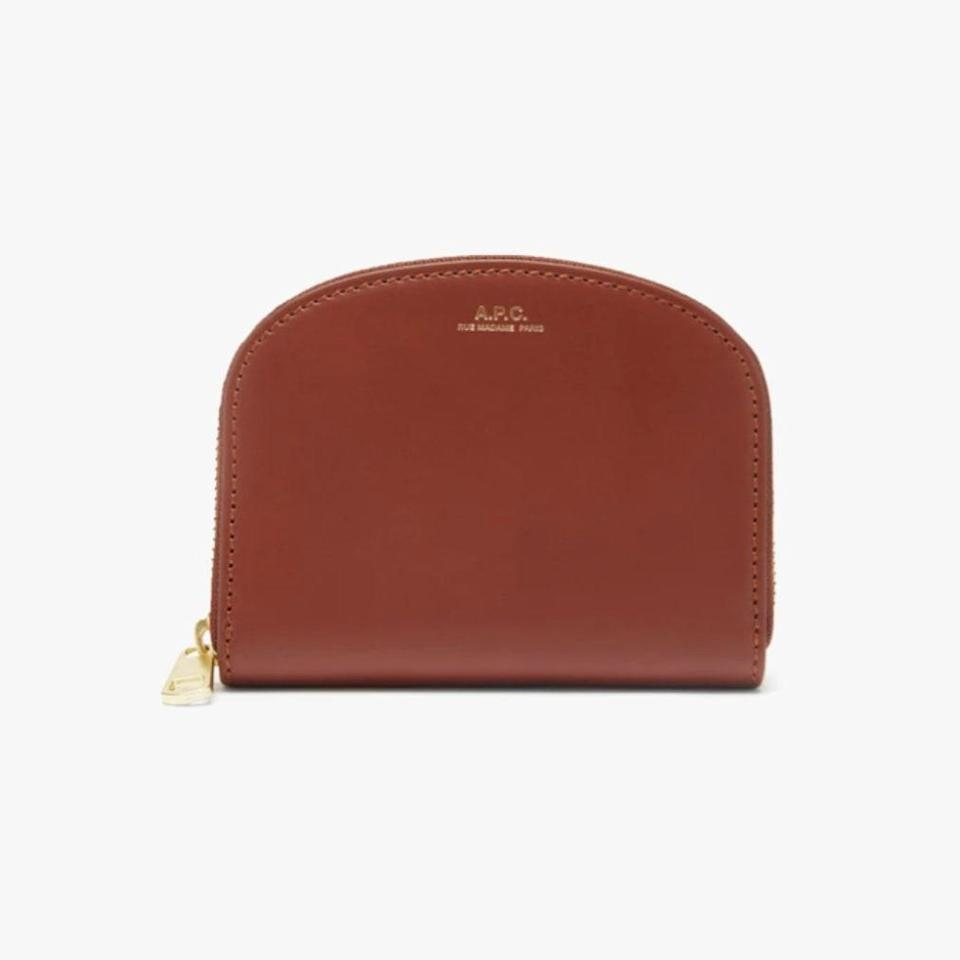 """$275, MATCHESFASHION.COM. <a href=""""https://www.matchesfashion.com/us/products/A-P-C--Half-Moon-zip-around-leather-wallet-1385139"""" rel=""""nofollow noopener"""" target=""""_blank"""" data-ylk=""""slk:Get it now!"""" class=""""link rapid-noclick-resp"""">Get it now!</a>"""