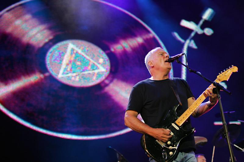 """An impromptu Pink Floyd cover band concert was broken up by the police, who are begging the public to stop having """"corona parties."""" (Photo: JOHN D MCHUGH/AFP via Getty Images)"""