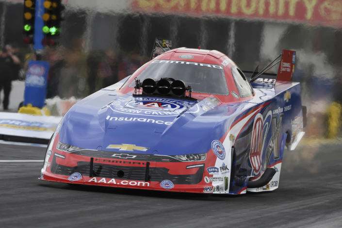 In this photo provided by the NHRA, Robert Hight tallies his fourth win at the at the Mopar Express Lane NHRA SpringNationals at Houston Raceway Park in Baytown, Texas, Monday, May 24, 2021, after rain on Sunday delayed racing. (Jerry Foss/NHRA via AP)
