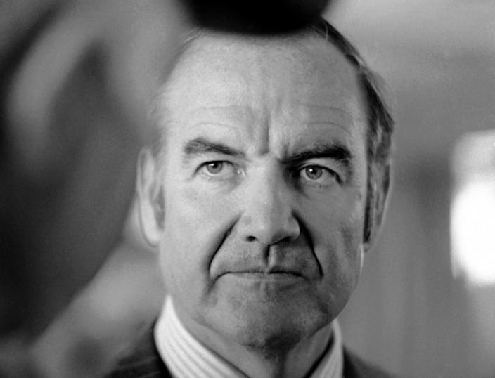 FILE - In this March 25, 1974 file photo, Sen. George McGovern of South Dakota listens to constituents as he arrives at Pierre, S.D. airport. A family spokesman says, McGovern, the Democrat who lost to President Richard Nixon in 1972 in a historic landslide, has died at the age of 90. According to the spokesman, McGovern died Sunday, Oct. 21, 2012 at a hospice in Sioux Falls, surrounded by family and friends.(AP Photo/Jim Mone, File)
