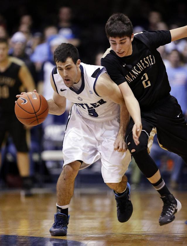 Butler guard Alex Barlow, left, heads up court after stealing the ball from Manchester guard Blake Brouwer in the first half of an NCAA college basketball game in Indianapolis, Monday, Dec. 9, 2013. (AP Photo/Michael Conroy)