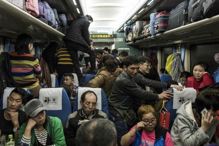 Passengers pack into a crowded train during the 26-hour journey from Beijing to Chengdu, as they head home ahead of the Lunar New Year