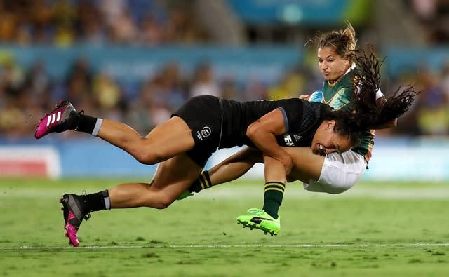 New Zealand's Portia Woodman, left, produces a powerful tackle on South Africa's Chane Stadler during the pool stage of the women's rugby sevens at the 2018 Commonwealth Games in Gold Coast, Australia. New Zealand won the match 41-0 and went on to beat Australia in the final of the tournament (Mike Egerton/PA)