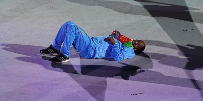 An Eritrean Olympian laid down on the ground during the marathon Olympic parade of nations