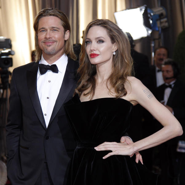 FILE - In this Feb. 26, 2012 file photo, Brad Pitt, left, and Angelina Jolie arrive before the 84th Academy Awards, in the Hollywood section of Los Angeles. Jasper Russo, the fine wine buyer for Sigel's wine and spirits store in Dallas, recently held a tasting of celebrity wines, including Miraval, a partnership between Jolie and Pitt and the Perrin French winemaking family. Miraval retails for about $24.99 and is made from grapes grown at Chateau Miraval, Pitt and Jolie's place in the south of France. (AP Photo/Amy Sancetta, File)