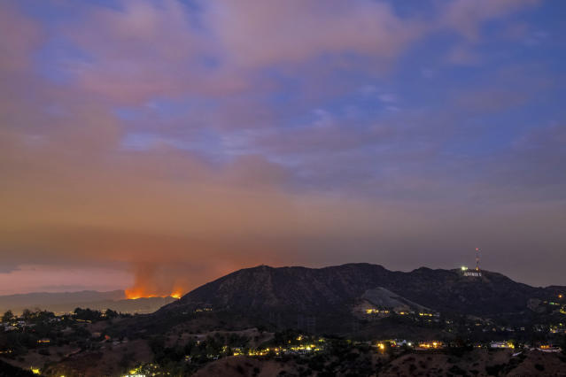 <p>In this Friday, Sept. 1, 2017 photo the La Tuna Fire burns, left, and the Hollywood sign seen at sunset from Los Angeles, Calif. (Photo: Ryan Astorga via AP) </p>