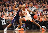 Mamadi Diakite #25 of the Virginia Cavaliers drives against Austin Wiley #50 of the Auburn Tigers during the first half of the semifinal game in the NCAA Men's Final Four at U.S. Bank Stadium on April 06, 2019 in Minneapolis, Minnesota. (Photo by Jamie Schwaberow/NCAA Photos via Getty Images)