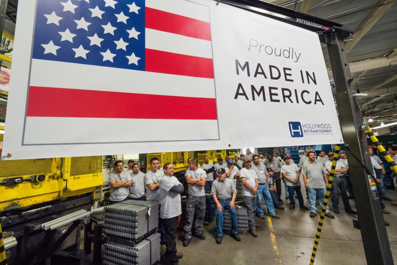 Workers at the Hollywood Bed Frame Company attend an event to mark the company's upcoming expansion which will double the manufacturer's workforce, adding 100 new local jobs, at the company's factory in Commerce, California, seven miles (11 km) southeast from downtown Los Angeles, April 14, 2017. Hollywood Bed Frame says it is one of a number of American companies benefiting from a commitment Walmart made last year to source an additional $250 billion in products made, assembled or grown in the US. / AFP PHOTO / Robyn Beck (Photo credit should read ROBYN BECK/AFP/Getty Images)