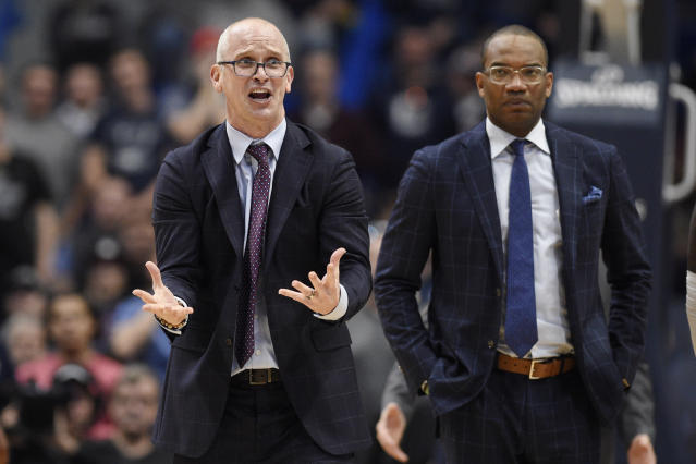 Connecticut head coach Dan Hurley, left, reacts toward an official as assistant coach Kimani Young, right, looks on in the second half of an NCAA college basketball game against Wichita State, Sunday, Jan. 12, 2020, in Hartford, Conn. (AP Photo/Jessica Hill)