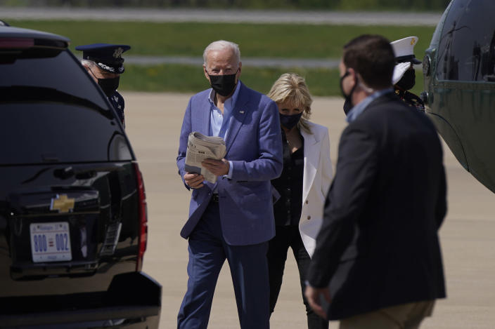 President Joe Biden and first lady Jill Biden walk to a motorcade vehicle after stepping off Marine One at Delaware Air National Guard Base in New Castle, Del., Saturday, April 24, 2021. The Bidens are spending the weekend at their home in Delaware. (AP Photo/Patrick Semansky)