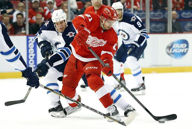 Winnipeg Jets defenseman Adam Pardy (2) defends against Detroit Red Wings' Tomas Tatar (21), of the Czech Republic, during the second period of an NHL hockey game in Detroit, Tuesday, Nov. 12, 2013. (AP Photo/Paul Sancya)