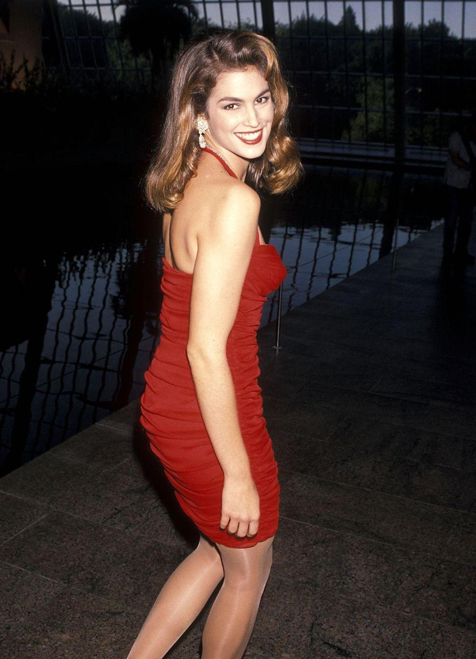 <p>In 1990, supermodel Crawford attended a Revlon event at New York City's Metropolitan Museum of Art in a striking red dress. <br></p>